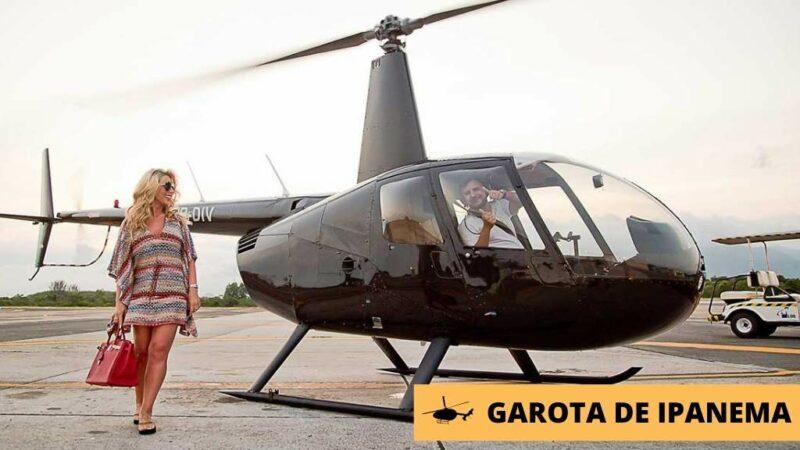 Mulher embarcando no helicóptero para fazer passeio no rio de janeiro.
