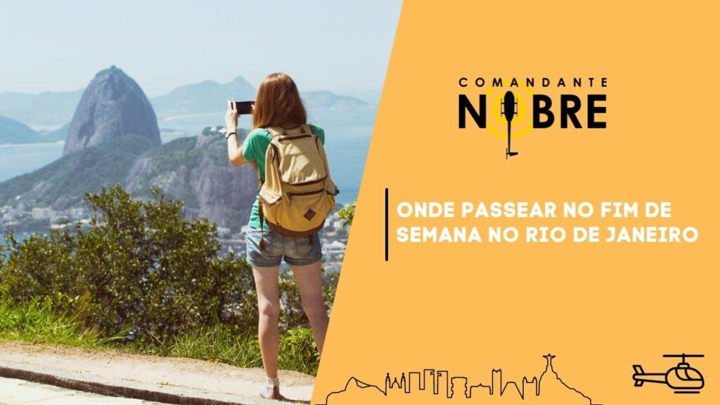 Mulher jovem fotografando a pedra da gávea no Rio de Janeiro.